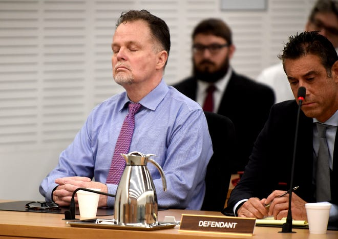 """Charles """"Chase"""" Merritt, left, reacts June 10, 2019, after being found guilty of four counts of first-degree murder of the McStay family."""