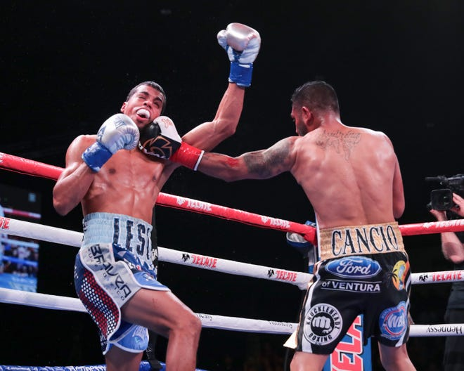 Andrew Cancio, left, lands a shot to the face of Alberto Machado during their fight Friday at Fantasy Springs Resort Casino.