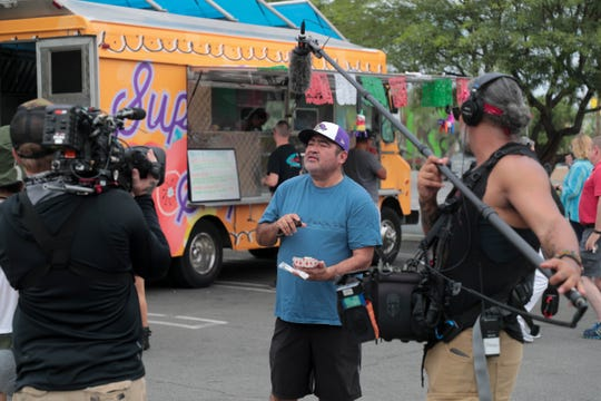 A man is interviewed in front of Super Sope food truck from Food Network's 'The Great Food Truck Race' on Tuesday, June 25, 2019 in Palm Springs, Calif.