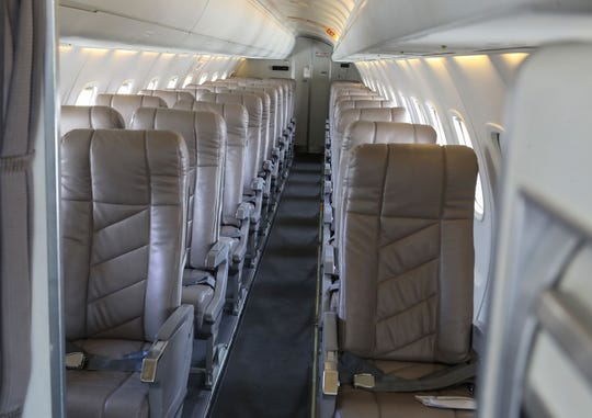 Contour Airlines Embraer ERJ-135 regional jets have leather seats and 36 inches of legroom.