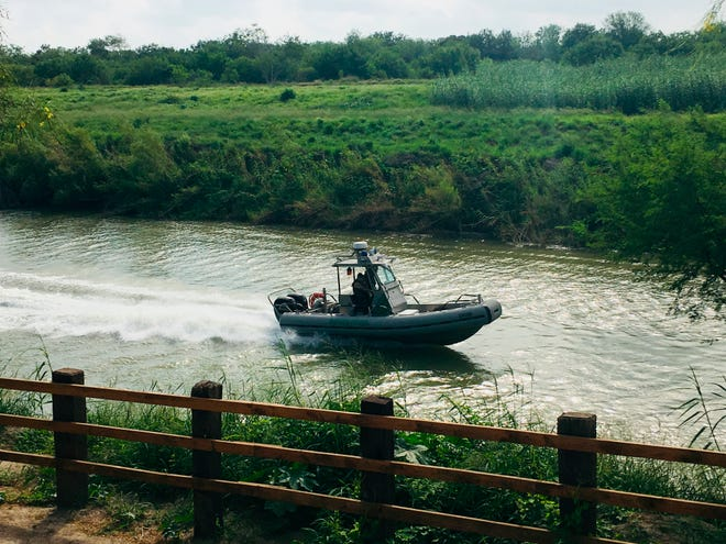 A U.S. Border Patrol boat navigates the Rio Grande near where the bodies of Salvadoran migrant Oscar Alberto Martínez Ramírez and his nearly 2-year-old daughter Valeria were found, in Matamoros, Mexico, on Monday, June 24, 2019, after they drowned trying to cross the river to Brownsville, Texas.