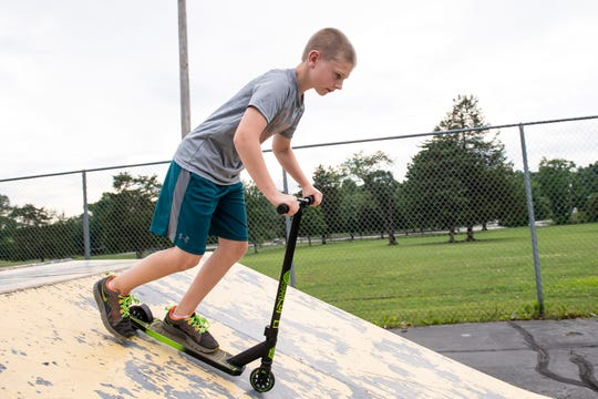 Josh Shorb, 10, rises his scooter at Gettysburg Recreational Park on Wednesday, June 19, 2019. Josh was diagnosed eight years ago with Kawasaki disease, a rare childhood syndrome that swells the interior walls of the coronary arteries.