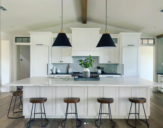 The Goldman kitchen, inspired by images Jenny found on social media, is symmetrical, white and filled with clean space.