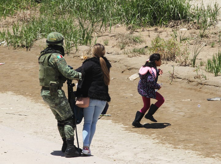 Mexico National Guard members prevent Central American migrants from crossing the Rio Bravo in Juarez, Chihuahua, on June 21, 2019.