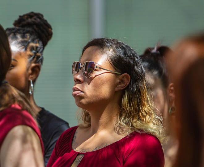 Erica Reynolds, who says a Phoenix police officer sexually assaulted her, stands behind her lawyer, Heather Hamel, during a press conference held on June 24, 2019, outside of Phoenix City Hall.