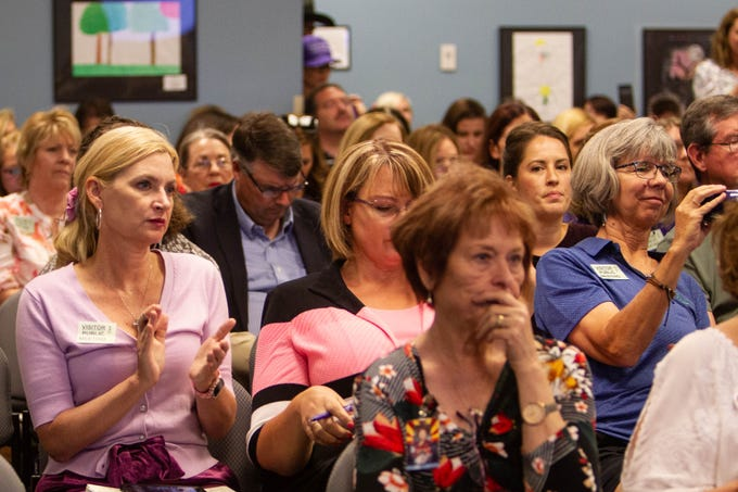 'Purple for Parents' members and Arizona legislators protest the proposed changing of sex education guidelines in public schools on June 24, 2019, at the Department of Education.