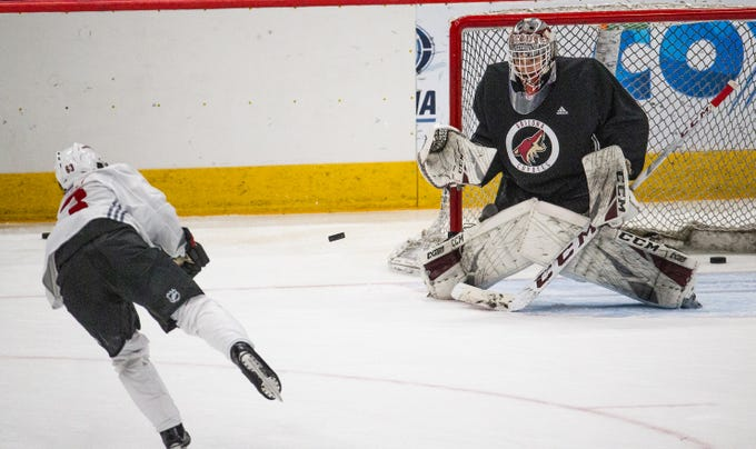 Arizona Coyotes hold a development camp at Gila River Arena, Tuesday, June 25, 2019.   Forward Matias Maccelli shoots on goalie David Tendeck.