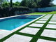 The Goldmans mixed artificial grass along stepping stones in the backyard with a large section of real grass for their beloved goldendoodle to enjoy.
