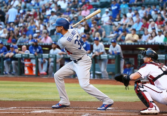 Los Angeles Dodgers Cody Bellinger hits an RBI-double against the Arizona Diamondbacks in the first inning on June 24, 2019 at Chase Field in Phoenix, Ariz.