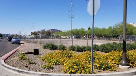 Developers hope to turn this vacant strip of land on Farmer Avenue in Tempe into a hotel.