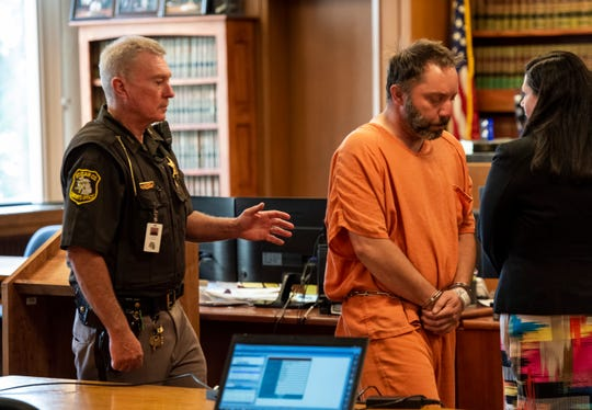 Jonathan Stahl, right, is lead out of St. Clair County District Judge Cynthia Platzer's courtroom after a probable cause hearing Tuesday, June 25, 2019. Stahl is being charged with first-degree murder in the death of his father.