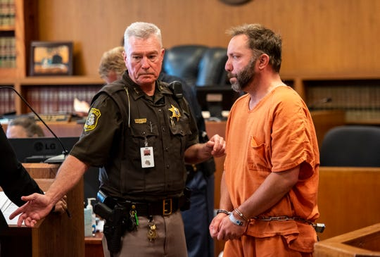Jonathan Stahl, right, is lead into St. Clair County District Judge Cynthia Platzer's courtroom for a probable cause hearing Tuesday, June 25, 2019. Stahl is being charged with first-degree murder in the death of his father.