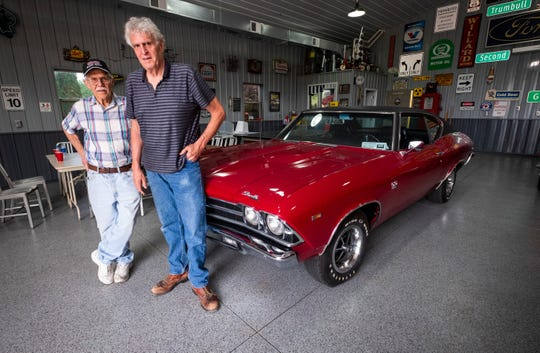 Bob McLaren, right, poses with his former shop teacher Jack Munkabee and the 1969 Chevelle they restored. Munkabee bought the car, and in the early 1980's, he stripped the car down with his shop class, which McLaren was in. Several years later, they began restoring the vehicle together, and upon completion Munkabee signed the car over to McLaren.