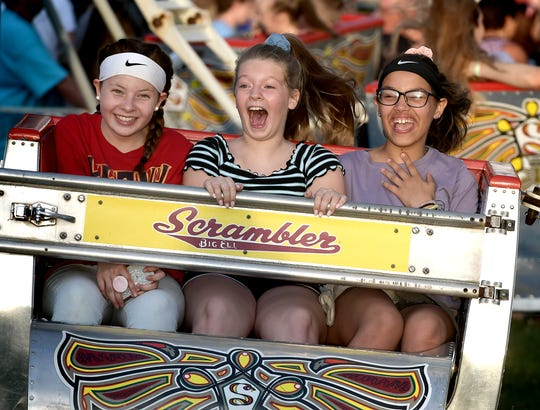Riders, from left, Cassidy Anderson, 12, of Red Lion; Nevaeh Stewart, 11, of Shrewsbury, and Breah DeJohn, 11, of New Freedom, take a spin on the Scrambler at the Shrewsbury Fireman's Carnival Monday, June 24, 2019. The carnival, featuring live music nightly, runs through June 29. It opens at 5:30 each night. Bill Kalina photo