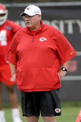 Kansas City Chiefs head coach Andy Reid watches drills during the NFL football team's organized team activities Thursday, June 6, 2019, in Kansas City, Mo. (AP Photo/Charlie Riedel)