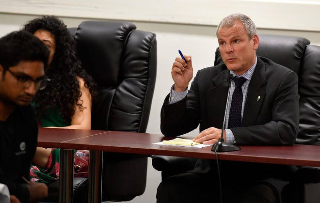 York City Council Mayor Michael Helfrich responds during a town hall meeting concerning his hiring of Blanda Nace as chief opportunity development officer, Monday, June 24, 2019. John A. Pavoncello photo