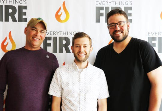 Harrison Smith (left), Matt Nease (center) and Doug Henderson (right) pose for a photo at the Everything's Fire studio in downtown York on June 25.