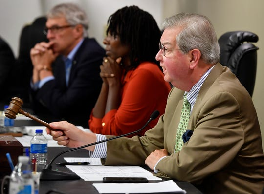 York City Council President Henry Nixon tells Tonya Thompson-Morgan, not shown, she is out of line during a town hall meeting concerning Mayor Michael Helfrich's hiring of Blanda Nace as chief opportunity development officer, Monday, June 24, 2019. 