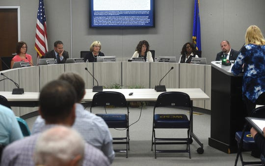 WCSD Board of Trustees President Katy Simon Holland, middle left, and Acting Superintendent Kristen McNeill, middle right, preside over the Washoe County School District board meeting in Reno on June 25, 2019.