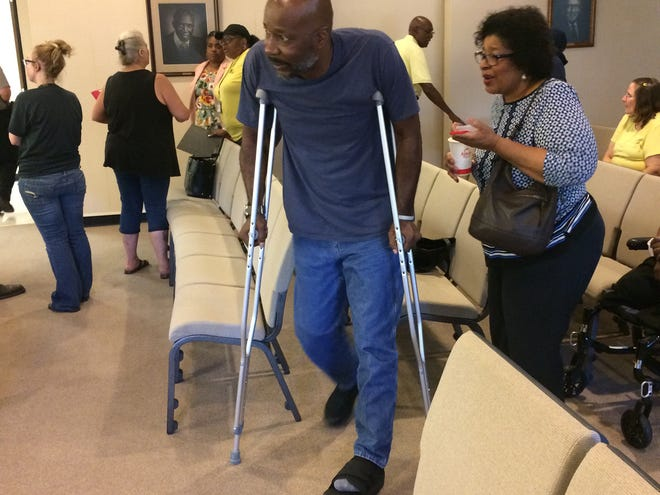 Ron Lundy uses crutches because of his injured left foot as he leaves a vicious dog hearing Tuesday, June 25, 2019.