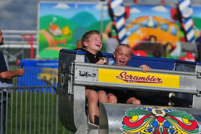 Fair-goers ride Scrambler on Monday, June 24, 2019, at the Wayne County 4-H Fair.
