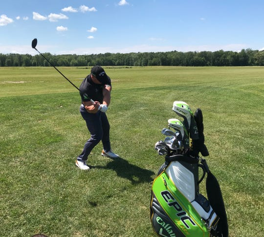 Rochester Ryan Steenberg, 36, hit a few ceremonial drives for 'Roc City Rumble' on Tuesday at Home Team Sports Park, a driving range facility on Ballantyne Road in Chili that is under progress.