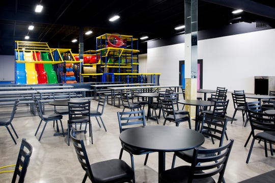Tables and chairs are set up in the cafe area of Awesome Indoor Playground in Salem on June 24, 2019. The menu includes sandwiches, salads, pizza, small plates, coffee products along with a wine and beer selection.