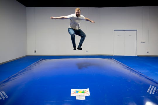 Co-Owner Jacob Biber shows how kids can jump on a jumping pillow trampoline at Awesome Indoor Playground in Salem on June 24, 2019.