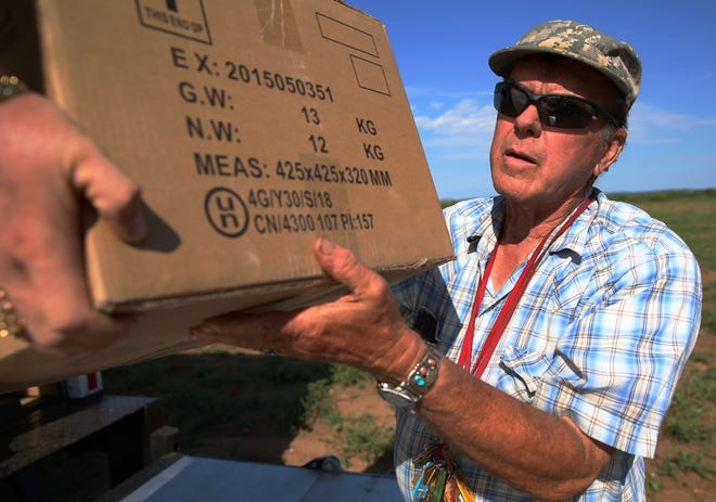 Ken Landon unloads a box of fireworks on Saturday that will be part of the two shows he designs every Fourth of July in San Angelo.