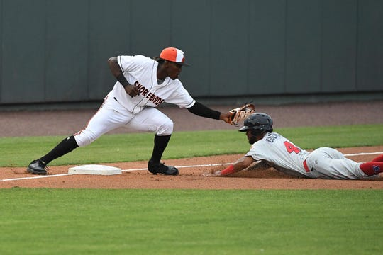 Delmarva Shorebirds JC Encarnacion tries to tag the runner against the Lakewood Blueclaws at the Arthur W. Perdue stadium on Monday, June 24, 2019.