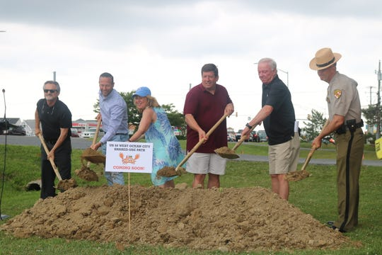 From left: Jay Meredith, Greg Slater, Mary Beth Carozza, Rick Meehan and Earl Starner break ground on a new pedestrian pathway in West Ocean City on June 25, 2019.