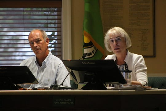 From left: Berlin Councilman Troy Burnell and Town Administrator Laura Allen listen to the concern of a community member at a Town Council meeting on June 24, 2019.