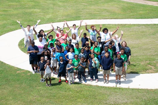Students celebrate the new walking track at Bossier Elementary School.