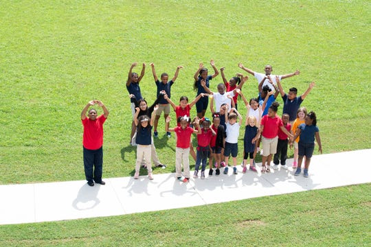 Students celebrate the new walking track at Plantation Park Elementary School.