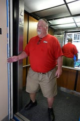 Kenny Parr points out rennovations to be made in the Independence Stadium elevators