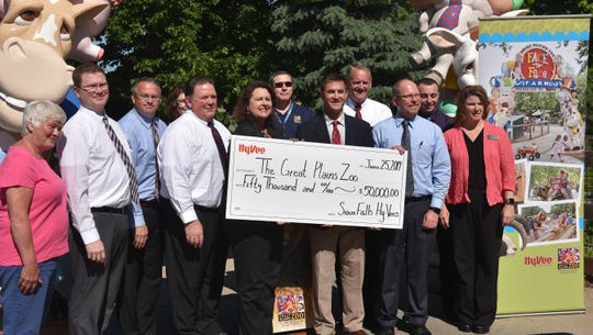 Empire Hy-Vee store director Matt Heldenbrand presents a $50,000 check to Great Plains Zoo President and CEO Elizabeth Whealy at Great Plains Zoo Tuesday Morning.