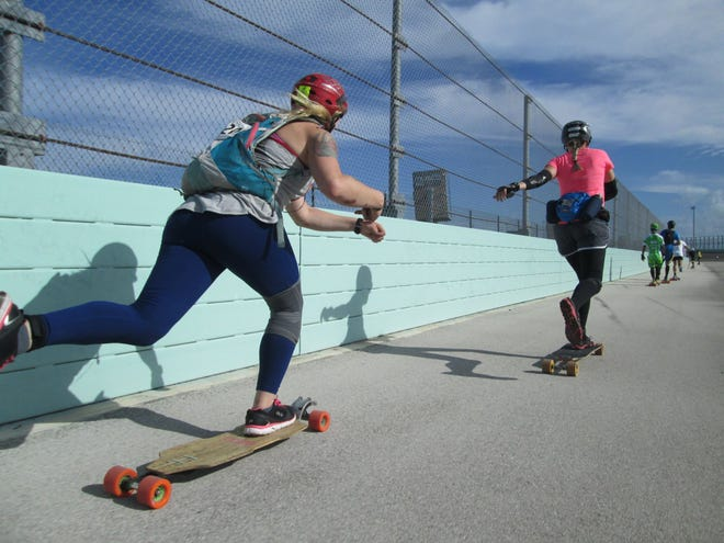 Skateboarders competing in distance skateboarding competition.
