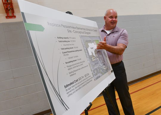 Dave Bergeron of ICS Consulting talks about ideas for a new Pleasantview Elementary School location during an ice cream social Tuesday, June 25, 2019, at Rice Elementary School.