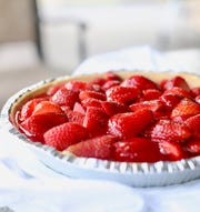 Fresh berries are topped with a strawberry jello glaze and chilled.