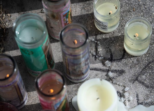 Decorated cars, candles, balloons, stuffed animals and a rosary were among the tributes to the slain Felix Rivera, 54, and a 8-year-old child at the scene of a double homicide, seen Tuesday, June 25, 2019 at Waterleaf Apartments in Port St. Lucie. Police say Alyssa Torres, 29, shot and killed her stepfather and daughter and injured her mother early Monday morning. She is booked at the St. Lucie County Jail on two counts of murder and a single aggravated battery with a deadly weapon charge.