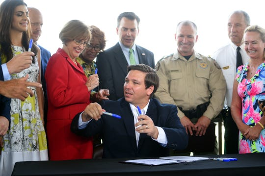 Florida Gov. Ron DeSantis signed a bill on Tuesday, June 25, 2019, transferring enforcement of environmental crimes from the Florida Fish and Wildlife Conservation Commission to the Department of Environmental Protection.