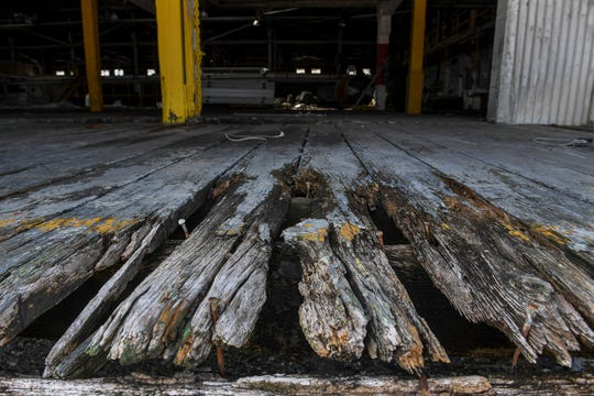 Weathered and worn boards are seen at the end of a loading dock at the former citrus packing house at the Port of Fort Pierce on Tuesday, June 25, 2019, in Fort Pierce. The 83-year-old building at the port that once served as a citrus packing house will be torn down to make room for the new mega-yacht repair center operated by Derecktor Shipyards.