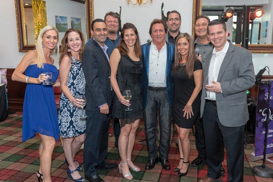 "De Anna Folds, left, Sonja Holbrook, Dr. Reza Ardalan, Joe Holbrook, Kimberly Ardalan, Dennis Fano, Big Brothers Big Sisters Trustee Josh Folds, Denise and Jason Bunk and Shaun Williams attend the sold-out ""Let the Good Times Roll"" event to benefit Big Brothers Big Sisters of Palm Beach and Martin Counties."