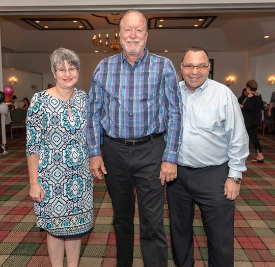 "Big Brothers Big Sisters Board Members Linda Mauger-Harnish, left, Chairman Ken Ringe and Treasurer Glenn Hasell at the sold-out ""Let the Good Times Roll"" event to benefit Big Brothers Big Sisters of Palm Beach and Martin Counties."