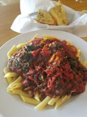 The Pollo Alla Roma, made of chicken breast, spinach, mushroomsand onions sauteed in house-made marinara sauce and served over penne pasta, had some hits and misses.