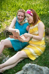 """Lauren Zbylski, left, plays Mistress Ford and Hannah Tamminen is Mistress Page in """"The Merry Wives of Windsor"""" being performed during the 23rd Annual Kingsmen Shakespeare Festival at Kingsmen Park at California Lutheran University in Thousand Oaks."""
