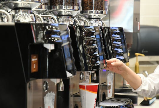 Customers pour coffee at Flying J truck stop during its Tulare grand opening on June 25, 2019.