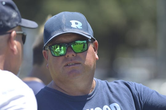 Kevin Scharton is in his first season as the head coach of the Redwood High School football program.