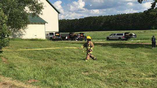 Firefighters remained on the scene nearly 12 hours after a fatal blaze broke out at a home in Langlade County on Tuesday, June 25, 2019. Six people were reported dead.
