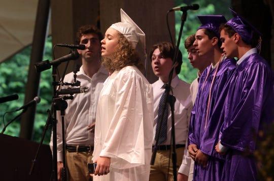 Graduate Mikaela Marcotullio sings with the Treblemakers at the John Jay High School graduation at Caramoor June 25, 2019 in Katonah.
